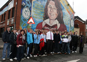 SEACHTAIN NA GAEILGE: Pupils from Coláiste Feirste and the Irish language college in Ballinderry, County Cork with Sinn Féin President Gerry Adams at Sevastopol Street in West Belfast