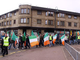 FLYING THE FLAG: Marchers were subjected to racism and sectarianism by counter-demonstrators