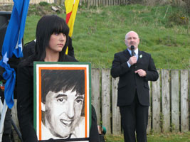 Geraldine Casey holds a portrait of her father
