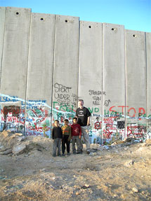 IN PALESTINE: Gerry Adams with Palestinian children at the Separation Wall
