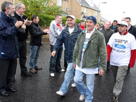 HEADS HELD HIGH: Gerry Adams and Bobby Storey applaud the Visteon workers