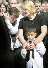LOSS: Kevin's widow, Evelyn, and son, 'Wee Ryan', at the graveside