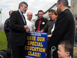 FIGHTING TALK: Gerry Adams and John Brady (centre) talk to worried Wicklow residents about the cuts in education