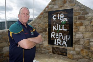 SICK ATTACK: Bobby Storey surveys the damage to the Republican Plot in Milltown cemetery