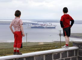 VIGILANT: Children watch Shell's pipelaying ship the Solitaire