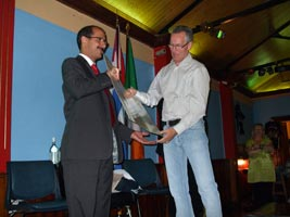 FUNCTION: Gerry Kelly presents funds collected by Sinn Féin to Noel Carillo