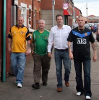 targeted, threatened and tortured: Liam Coogan, Charlie McMenamin, Jim McVeigh and Kevin Mulholland outside the Belfast Coiste na nIarchimí offices