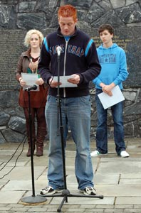 YOUNG REPUBLICANS: Liam Duggan, Maria O'Kane and Sean Bateson reading the Roll of Honour in the Garden of Rememberence
