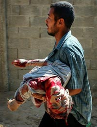 HARROWING SCENE: A father carries his dying child to a medical centre