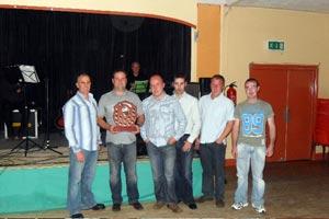 CONQUERORS: The winning team is Ciaran Hughes, Seán Hughes jnr, Stephen Rocks, Paddy Muldoon, and John O'Hara. The Brian Keenan Shield was presented by Banjo Bannon.