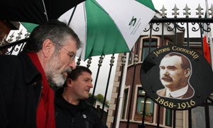 Gerry Adams and new Sinn Féin councillor, Caoimhín Mac Giolla Mhín at the unveiling