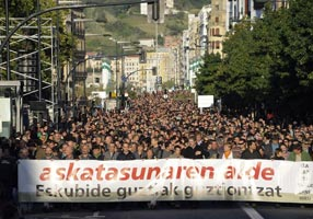 TAKING TO THE STREETS: Thousands of supporters march behind a banner reading 'For Freedom. Rights for All' in protest at the recent arrests