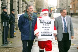 Santa Claus joined Gerry Adams and Aengus Ó Snodaigh to launch the campaign to have Christmas Social  Welfare payment restored