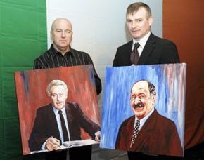 Terry Boyle and Cllr Jarlath McNulty with painted portraits of Ivan and Charlie