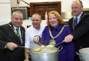 Danny Lavery, Naomi Long, Frank McCoubrey and chef Stephen Jeffers at Belfast City Hall
