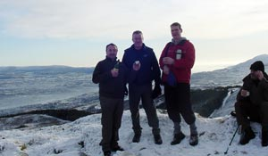 Newry/Armagh MP Conor Murphy MLA and his colleagues Councillors Terry Hearty and Pat McGinn make a toast to all Irish emigrants from the top of Camlough Mountain last Christmas morning
