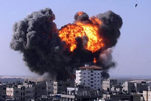 Explosions after an Israeli air strike in Gaza Strip in January 2009