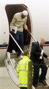 Binyam Mohamed, who was held at Guantanamo Bay, steps from a plane at Northolt military base in west London