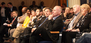Sinn Féin's Director of International Relations Padraic Wilson sitting with some of the international speakers
