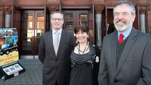 Gerry Adams and Gerry Kelly with Director of An Chultúrlann Eimear Ní Mhathúna outside the Falls Road building