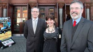 Gerry Adams and Gerry Kelly with Director of An Chultúrlann Eimear Ní Mhathúna outside the Falls Road building
