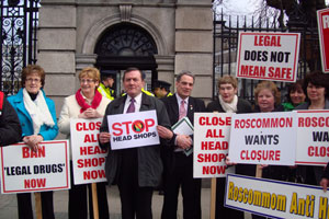Aengus Ó Snodaigh (pictured centre) joins citizens demonstrating against 'head shops' outside Leinster House on Wednesday afternoon