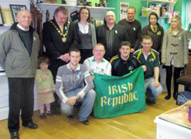 Seán Clarke, accompanied by members of the Tyrone Sinn Féin Commemoration Committee, at the Easter Lily launch in Omagh