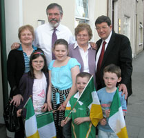 Pat McAnespie (widow of Sinn Féin Cllr Mickey McAnespie) and Margaret McMahon (widow of Sinn Féin Cllr Patsy McMahon) pictured with Gerry Adams, Pat Doherty and some young supporters in Omagh