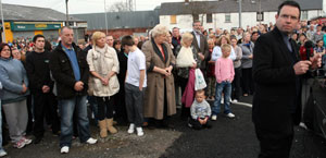 Gerry Adams joins Lenadoon residents to express their shock and anger at the killing of Seamus Fox