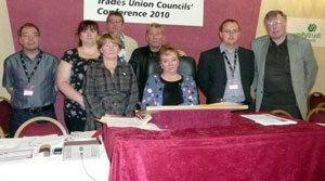 The relatives pictured with trade union officials at the Annual Conference of Trades Union Councils