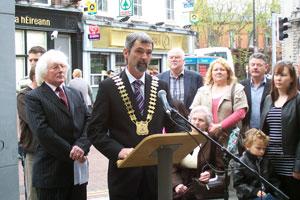 Monaghan Town Council Cathaoirleach Councillor Seán Conlon addressing the commemorative ceremony at the Dublin and Monaghan bombings memorial