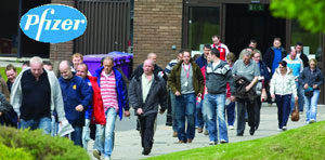 crippling blow: Workers leaving the Pfizer Plant after getting the news